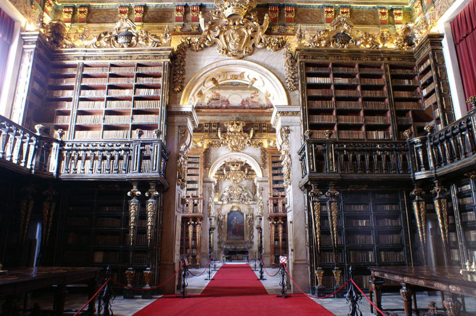 The Baroque Johannine Library at the University of Coimbra in Portugal is impressive