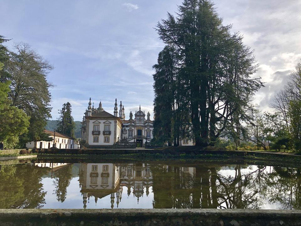 Mateus Palace in Portugal is reflected in the pool in front of it.