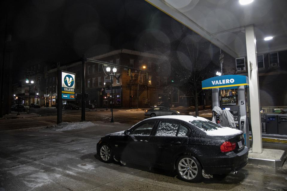 A man fuels up at a Valero in downtown Athens. A large snow...