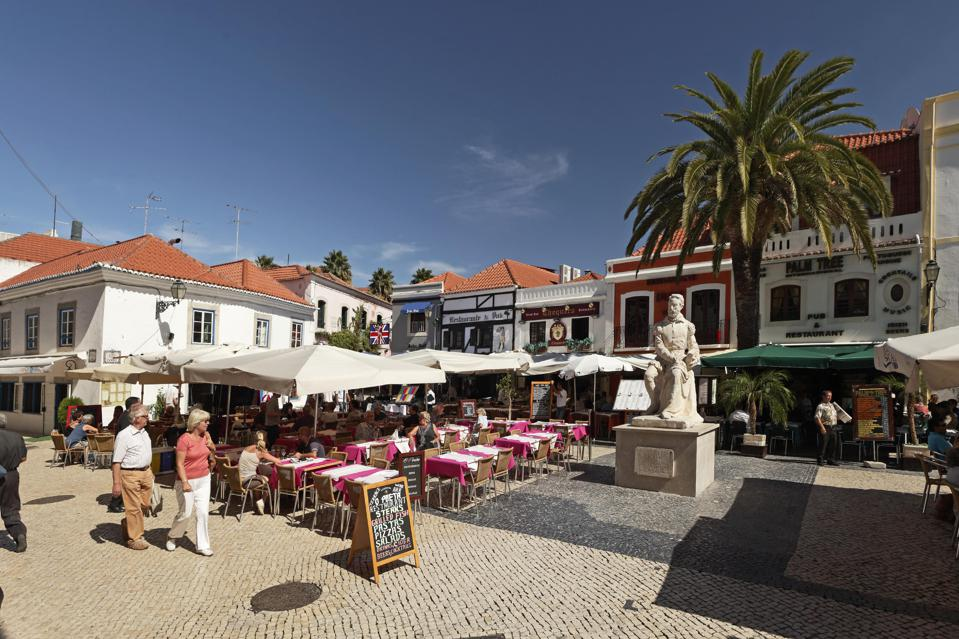 People stroll in the historic downtown of Cascais, near Lisbon, Portugal