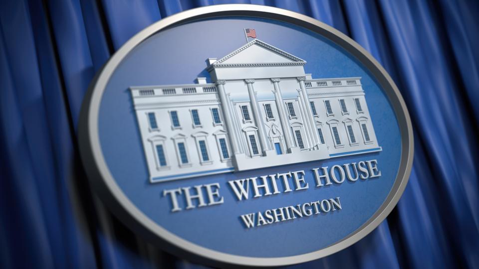 The White House Washington sign on blue background