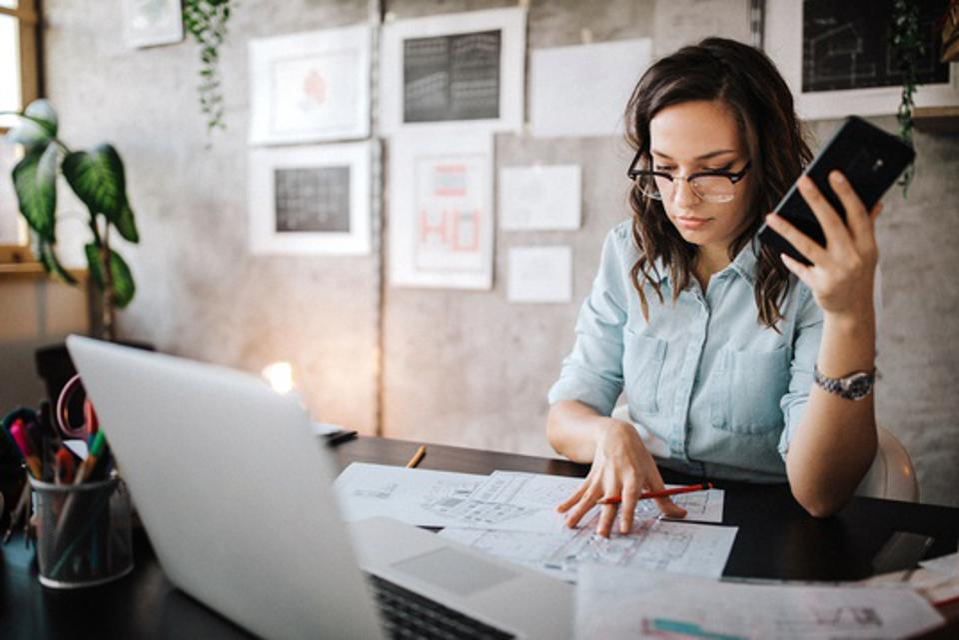 Young female entrepreneur working at desk