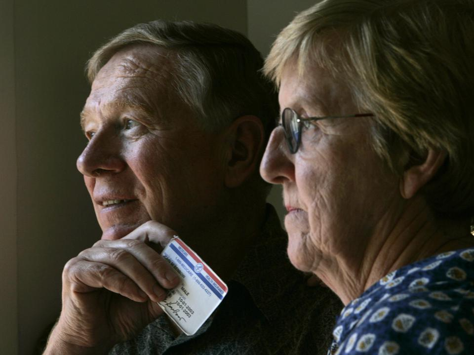 John and Mary Benbow, 67, and 68, respectively, of La Jolla, shown holding his finger over his soci