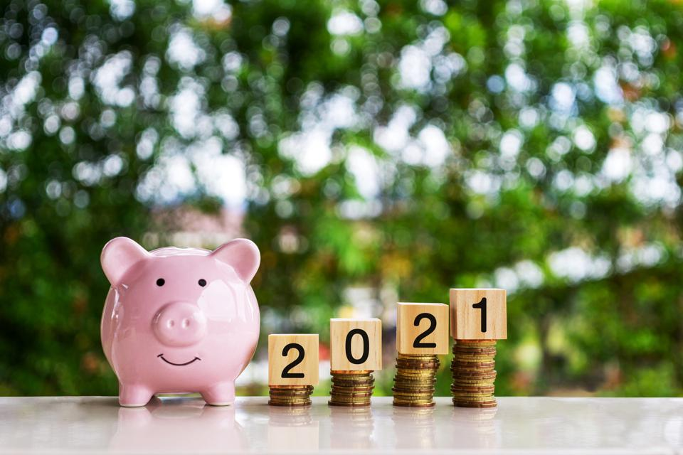 Piggy Bank, Stack of Coins and New Year 2021