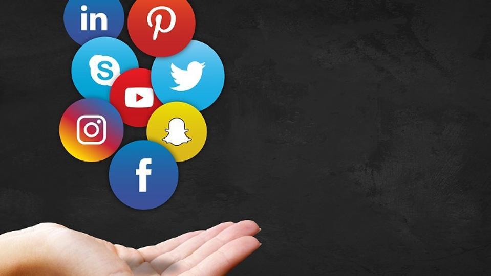 hand holding social media logos