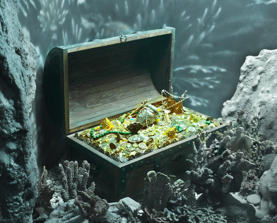 Treasure chest full of gold under the sea