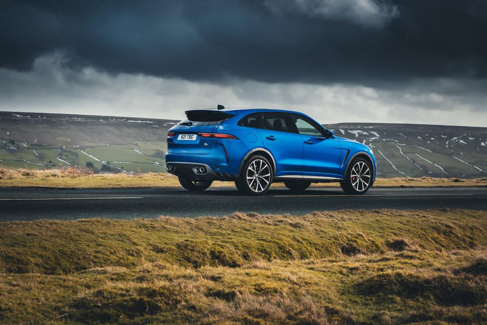 Rear three-quarter view of the 2021 Jaguar F-Pace SVR in blue