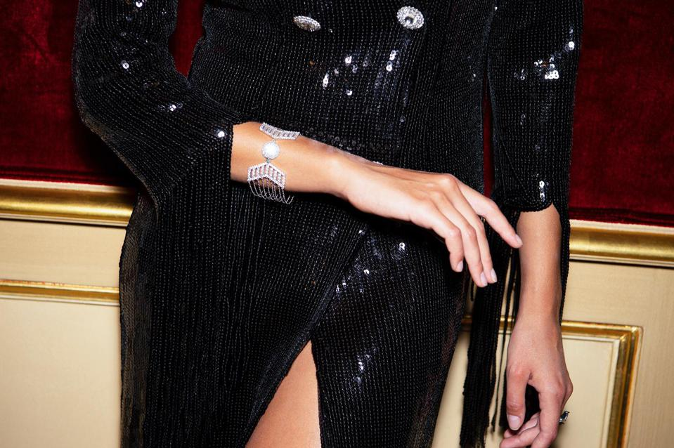 woman in black sequin dress with sparkly diamond bracelet with multi chain design