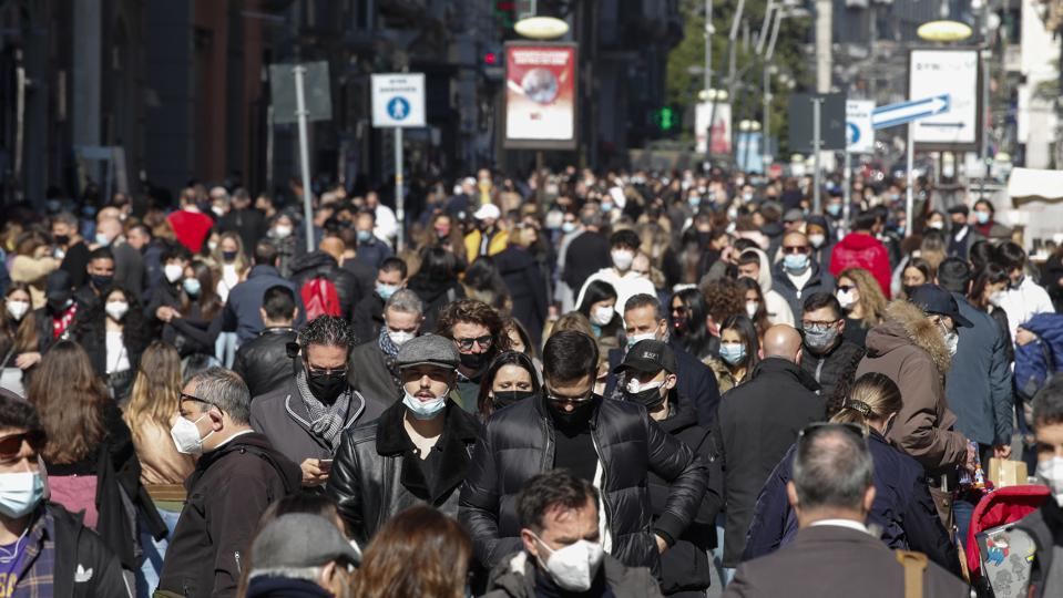 A huge crowd of people in Toledo street in Naples, one of...