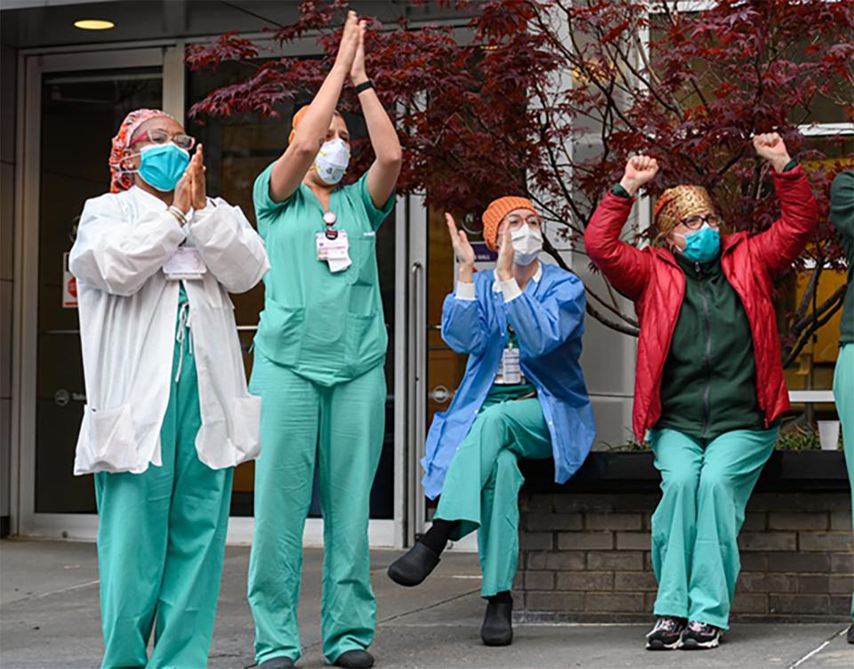 Health care workers applaud medical staff