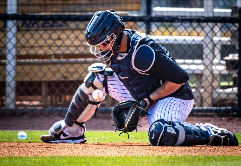 Catcher Gary Sanchez is working on defensive drills during spring training.