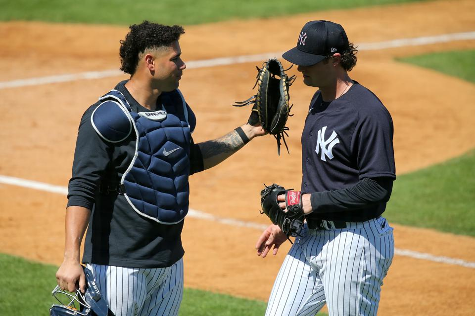 Yankees catcher Gary Sanchez talks with right handed pitcher Gerrit Cole after a workout.