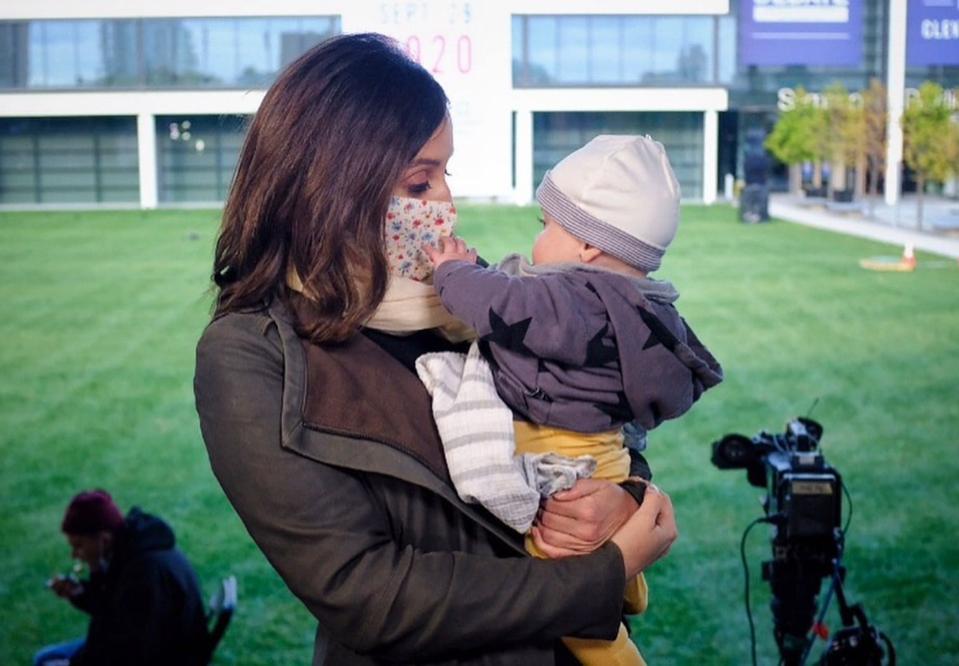 NBC News correspondent Hallie Jackson holds her baby daughter
