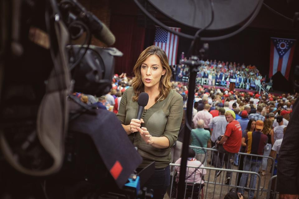NBC News correspondent Hallie Jackson holding microphone
