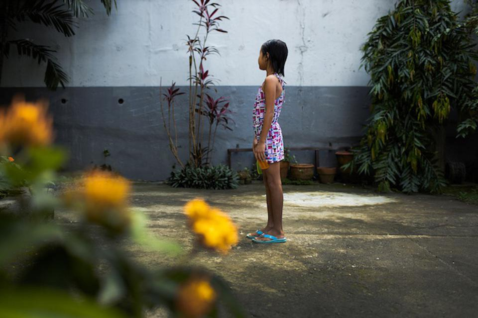 Nine-year-old Maryanne (not her real name) is seen in profile at the shelter where she lives in The Philippines.