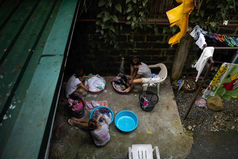 Girls wash their clothes at the shelter where they live in the Philippines.