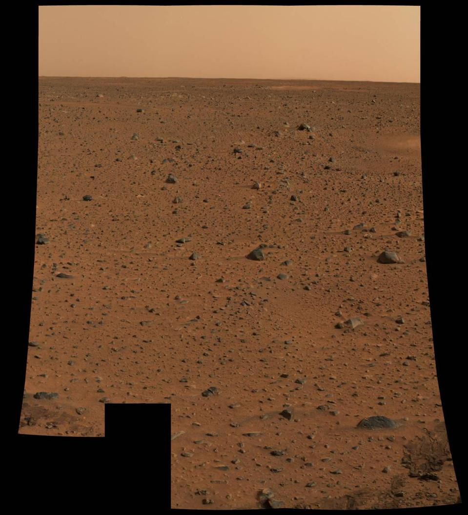 This image was the first color photo returned by NASA's Spirit rover from Mars.