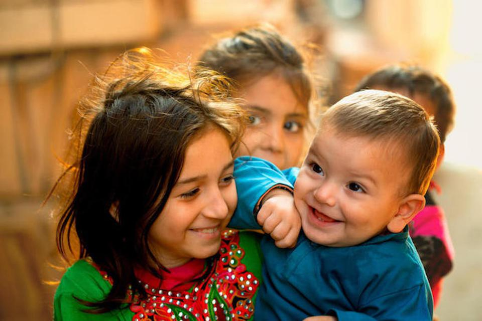 Smiling children in Lahore, Pakistan.