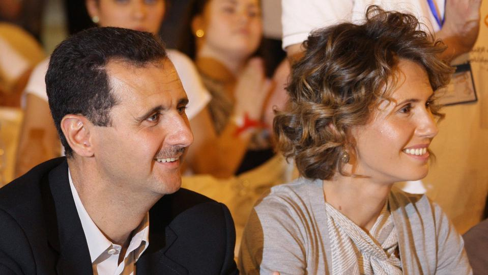 Syrian President Bashar Assad and his wi