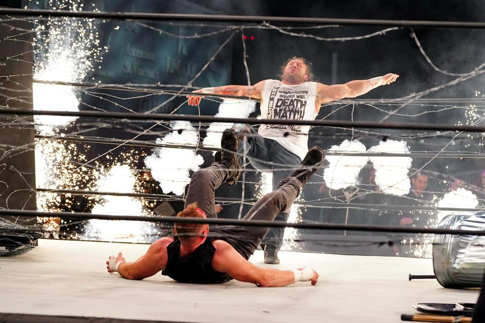 Kenny Omega and Jon Moxley in an Exploding Barbed Wire Death Match.