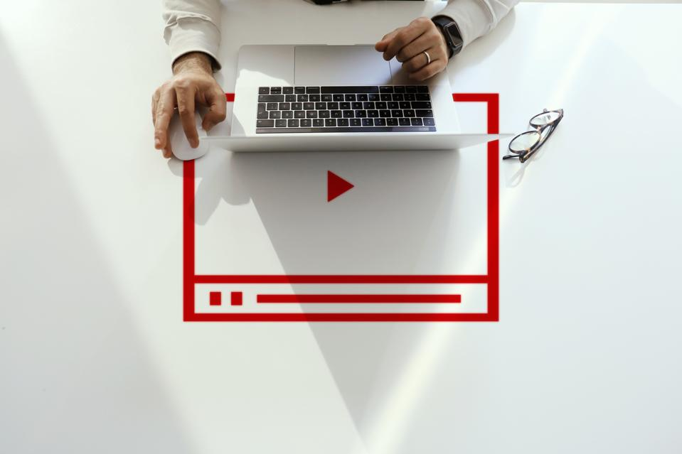 Video marketing concept. Person working on computer.