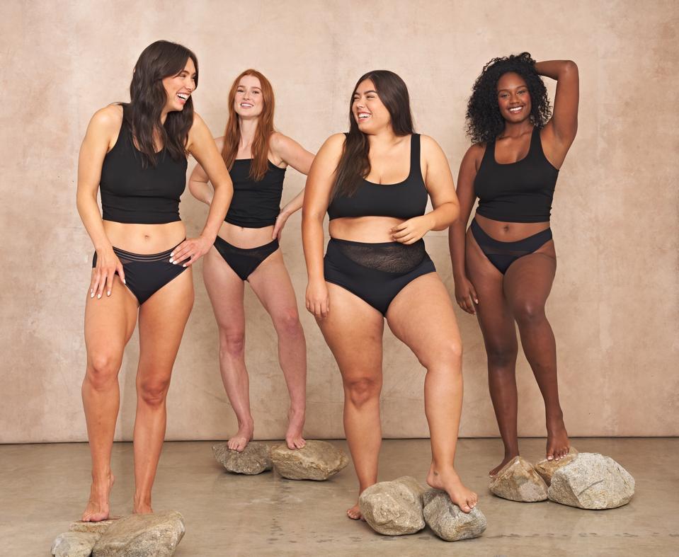 Four women wearing Saalt Elemental High Waist Briefs