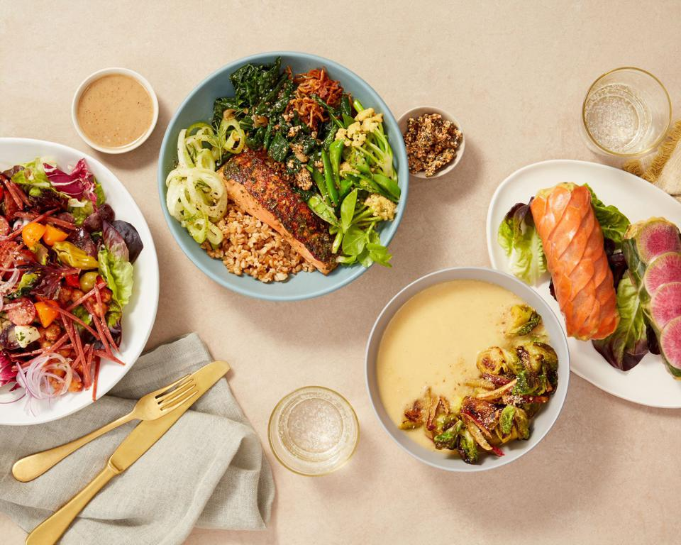 A tabletop display of goop's soups, salads and hearty bowls