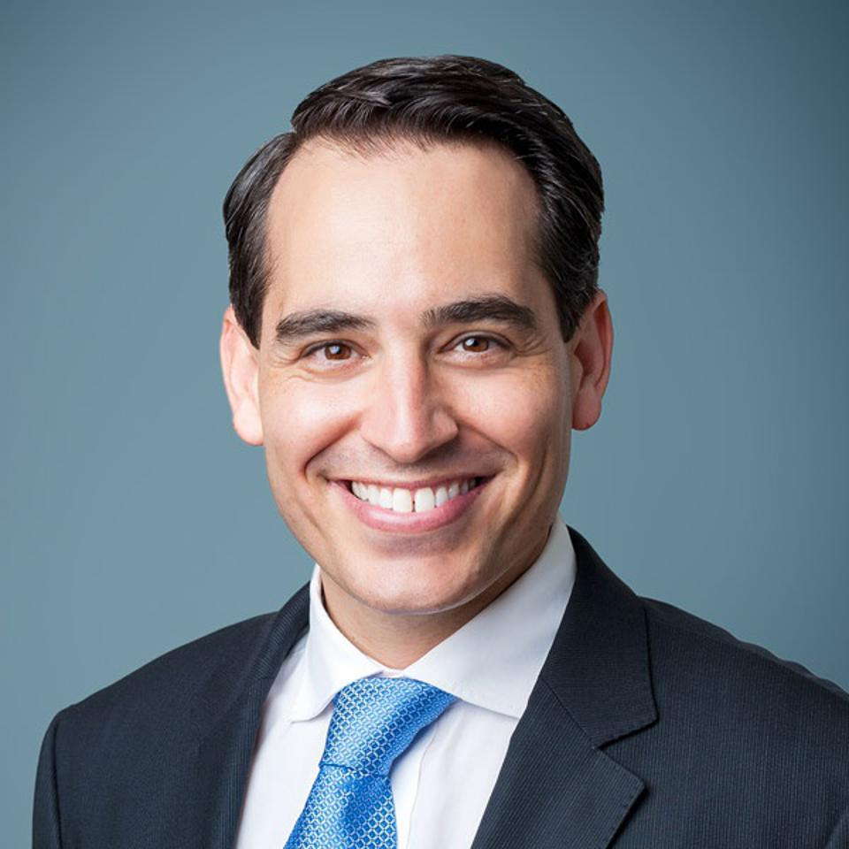 A headshot of Andy Kuper the founder and CEO of impact investing firm LeapFrog Invesments.