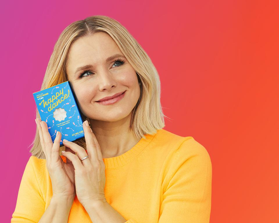 Kristen Bell hugs Happy Dance bath bomb