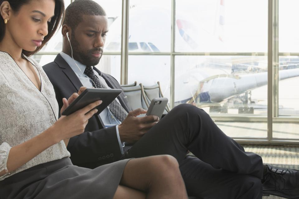 Business people using technology in airport
