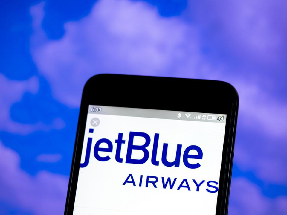In this photo illustration the JetBlue Airways logo is seen...
