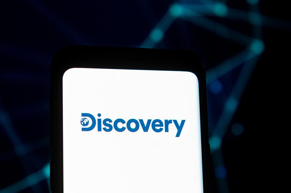 In this photo illustration a Discovery logo seen displayed...