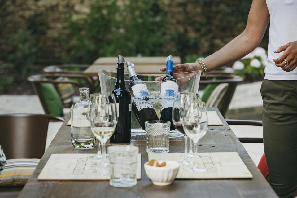 Lunch table with bottles of wine