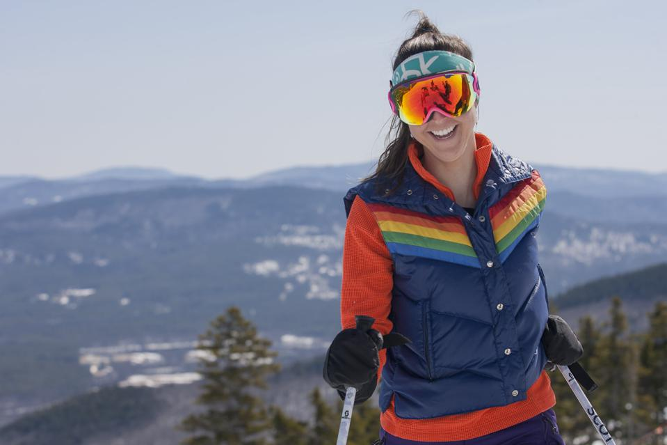 A woman skier smiling at Sunday River Ski Resort.