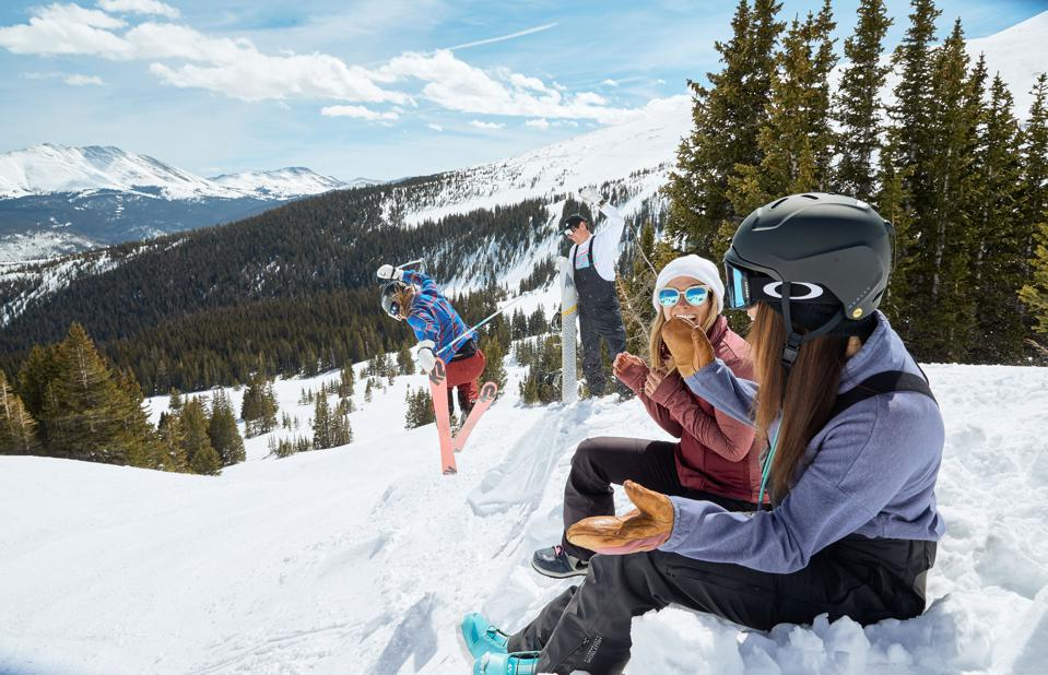 Three skiers enjoying themselves on a slope at Breckenridge.
