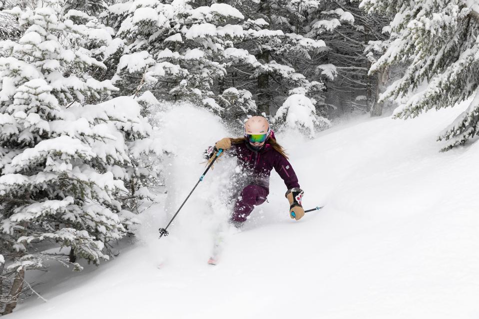 A long skier coming through a powder run at Stowe.