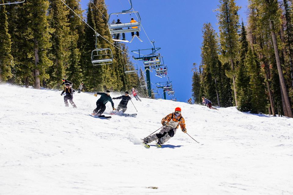 Skiers coming down a wide slope at Sun Valley.