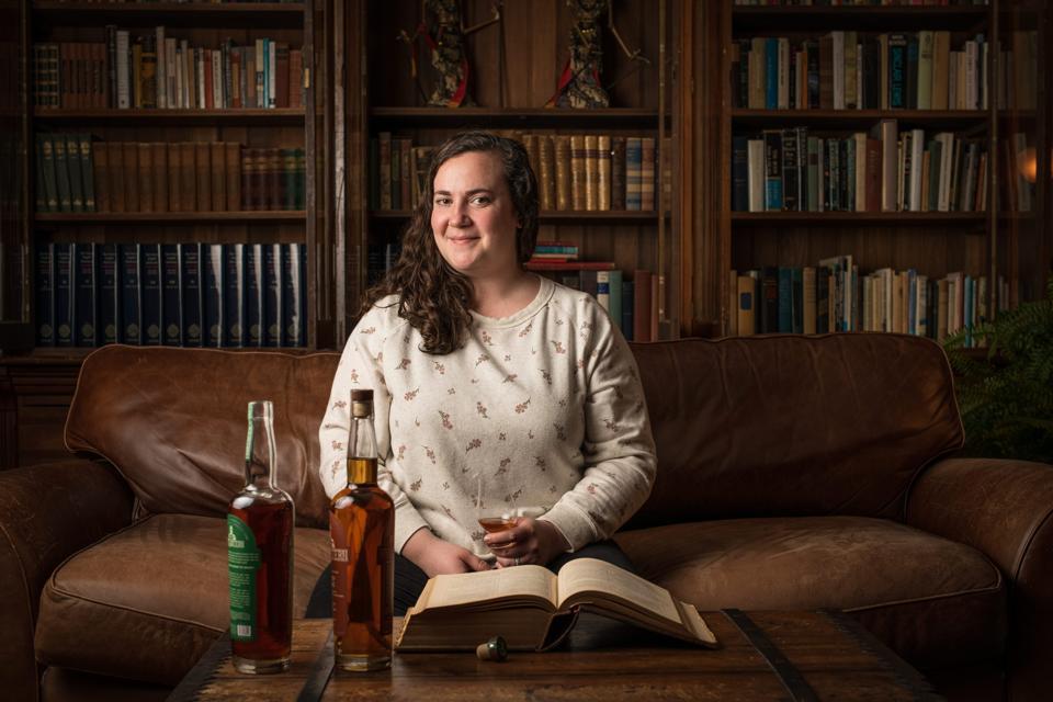 Lost Lantern co-founder Nora Ganley-Roper with 2 bottles