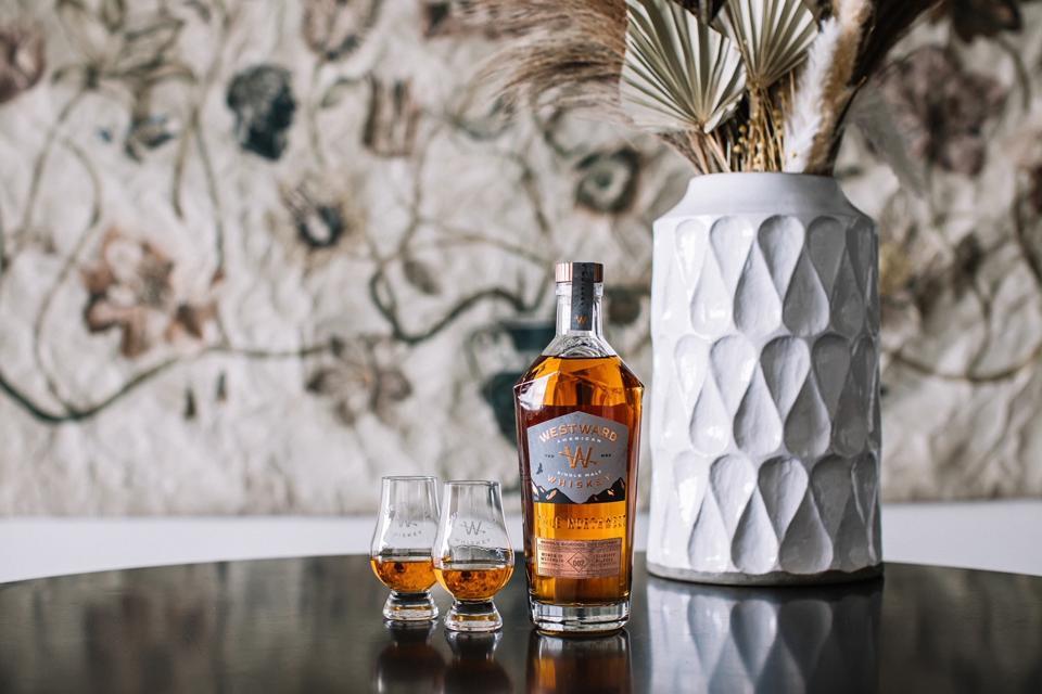 Bottle of Women of Westward Benefit Barrel Two American single malt whiskey with 2 glasses