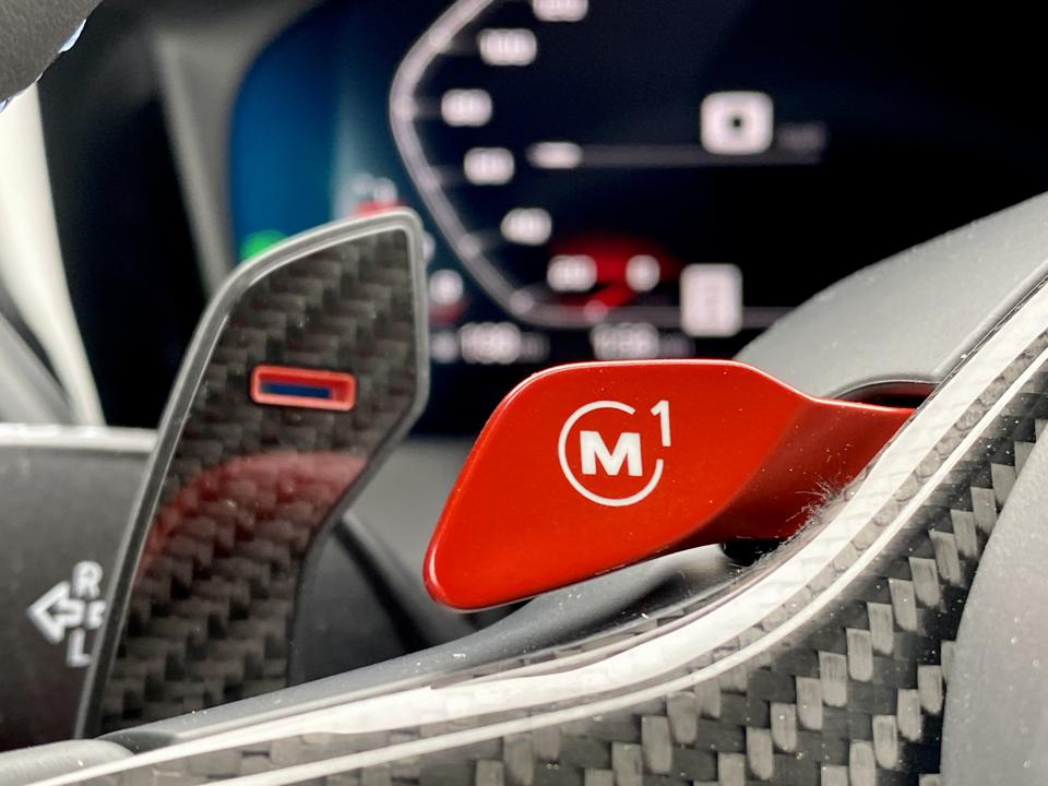 Red levers on steering wheel store individual preset calibrations.