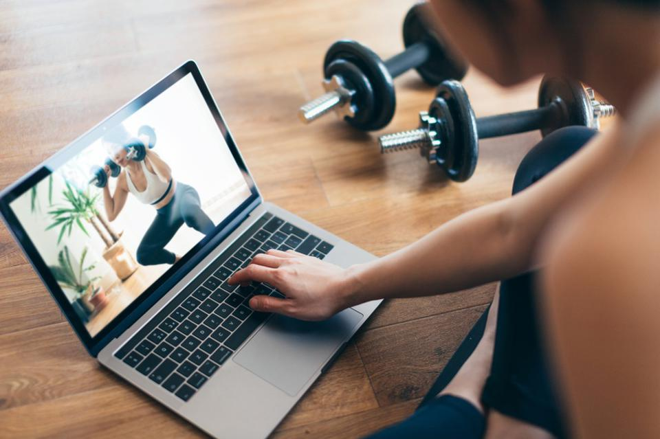 Weight Training Workout Through A Video Lesson On Laptop.