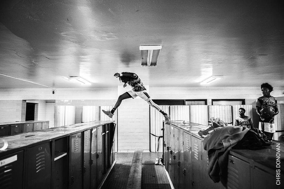 World Press Photo contest: Flint Jaguars team star Taevion Rushing jumping.