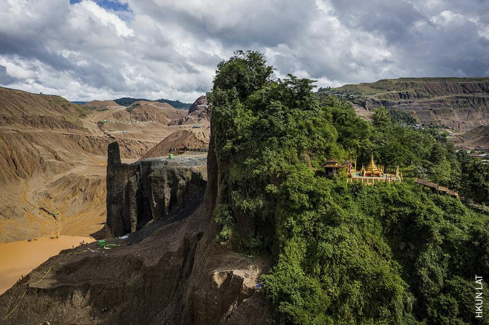 Buddhist temple occupies one half of a mountain, the other has been carved away