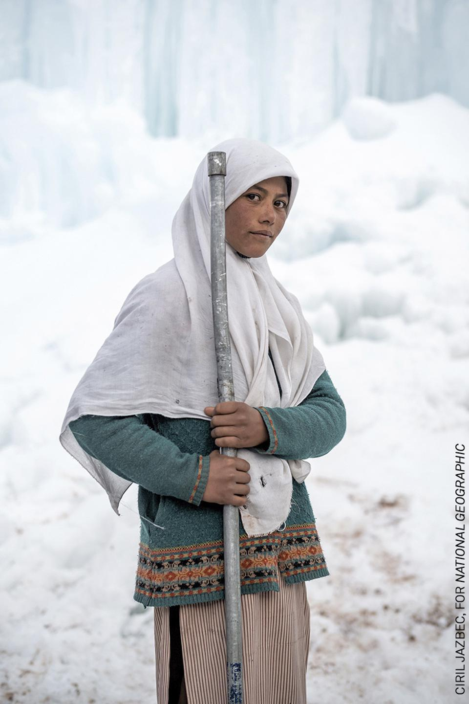 A young woman in front of a desert glacier