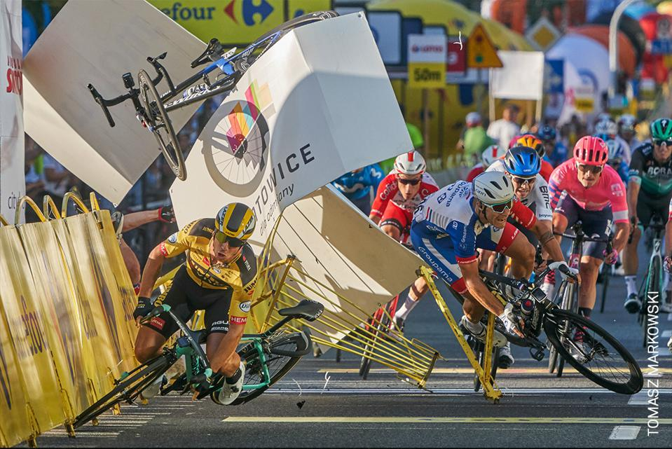 A Dutch cyclist crashes before the finish line, after colliding with a team member