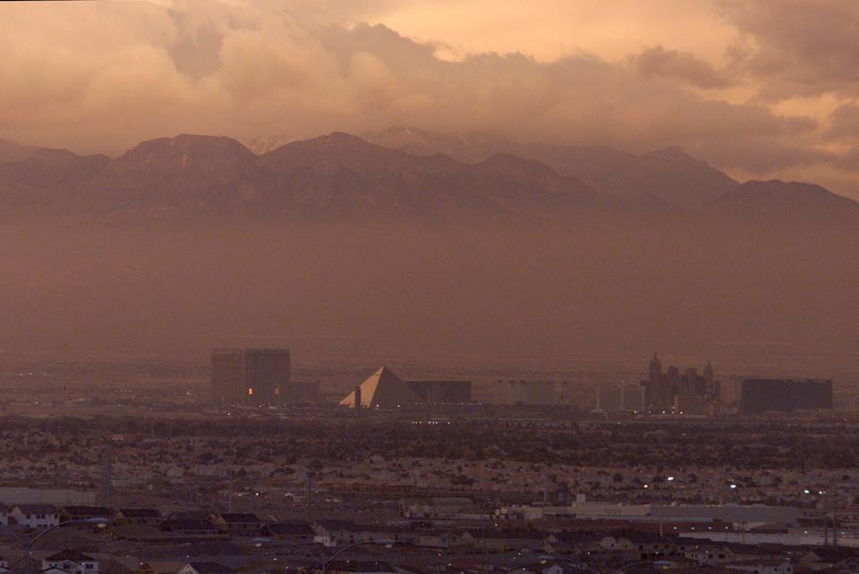 A layer of smog is visible over the Las Vegas strip at dusk in view taken from Interstate 515.