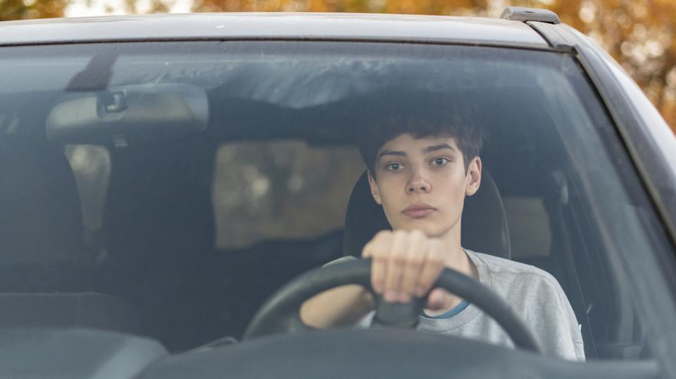 young teenager learns how to drive the car  f