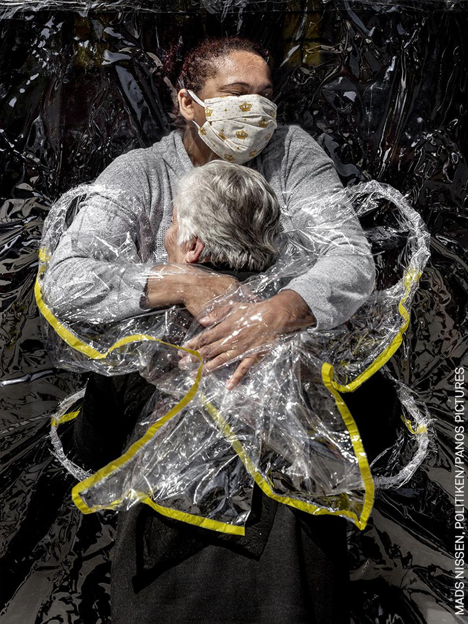 World Press Photo contest: An old lady in a nursing home is embraced by a nurse.
