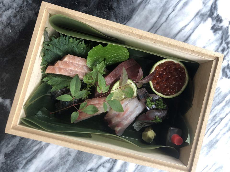 Sashimi is presented in a bento box for deliveries from Praia no Parque in Lisbon