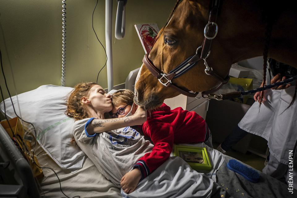 A mother with metastatic cancer with her son and a horse
